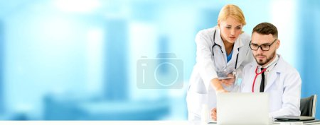 Photo for Doctor working with laptop computer at the office while having discussion with another doctor in the hospital. Medical healthcare and doctor service. - Royalty Free Image