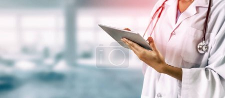 Photo for Doctor using tablet computer at the hospital. Medical healthcare and doctor staff service. - Royalty Free Image