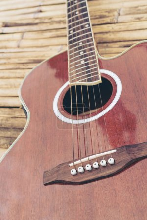 Photo for Classical guitar on wood background. Music and entertainment concept. - Royalty Free Image