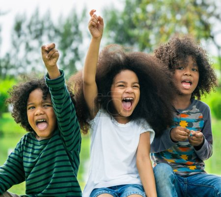 Photo for Happy African American boy and girl kids group playing in the playground in school. Children friendship and education concept. - Royalty Free Image