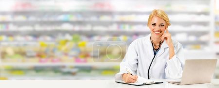 Photo for Pharmacist or doctor using laptop computer at the pharmacy room. Medical healthcare and pharmaceutical staff service. - Royalty Free Image