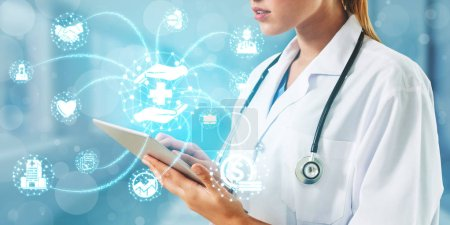 Photo for Medical Healthcare Concept - Doctor in hospital with digital medical icons graphic banner showing symbol of medicine, medical care people, emergency service network, doctor data of patient health. - Royalty Free Image