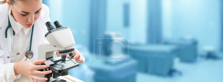 Photo for Scientist researcher using microscope in laboratory. Medical healthcare technology and pharmaceutical research and development concept. - Royalty Free Image