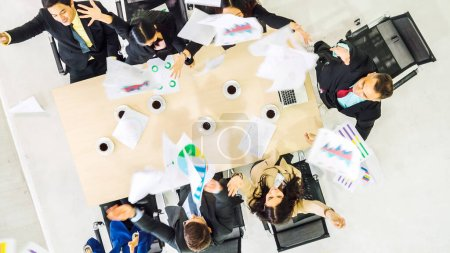 Photo for Successful business people celebrate together with joy at office table shot from top view . Young businessman and businesswoman workers express cheerful victory showing success by teamwork . - Royalty Free Image