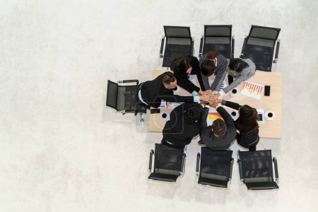 Photo for Happy business people celebrate teamwork success together with joy at office table shot from top view . Young businessman and businesswoman workers express cheerful victory showing unity and support . - Royalty Free Image